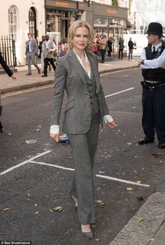 Ready for business: Nicole KidmanNicole was smart in a grey three-piece suit as she arriv...
