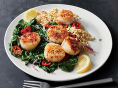 Make Spicy Seared Scallops With Chile-Garlic Spinach in 20 Minutes | The trick to perfect scallops is to leave them alone once they hit the pan—they'll stick to the skillet at first then release once they sear. If you prefer less heat, use just one Fresno chile and remove the seeds before adding to the pan.