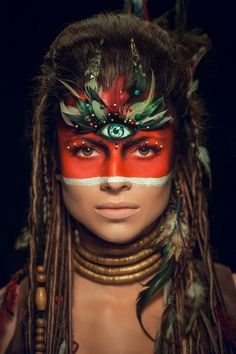 minus the third eye, I like the half red face and feathers