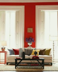Moder-White-Living-Room-with-Red-Wall-White-Sofa-and-Black-Coffee-Table