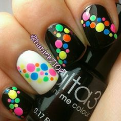 Neon dots on black and one white accent nail