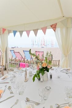 Beautiful beachy wedding marquee using bunting and peachy & pink rose for table centre piece. Marquee Hire, Marquee Wedding, Wedding Table, Our Wedding, Wedding Ideas, Coastal Wedding Venues, Wedding Locations, Beach Weddings, Devon Beach