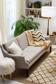 A sofa is incomplete without its favorite snuggle buddies—add a few textured pillows and throws for the perfect date night (or day date) couch. Adorable.