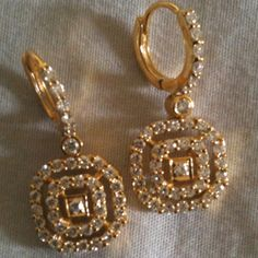 Earrings with 1 ct diamonds , 4 g gold.