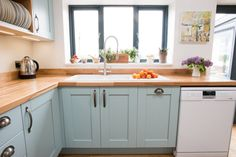 Blue shaker kitchen with beech worktops - Sheffield Sustainable Kitchens