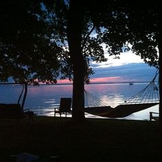 Relaxing by the lake back home in Quebec.  #lacsaintfrancois #quebec #hammock #sunset