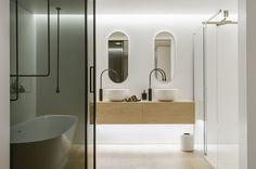 Bathroom, Alluring Contemporary White Bathroom Interior With Acrylic Bathtub Bright Scheme Floating Wooden Vanity Mirror Ceiling Lamp Rug Hardwood Floor Sink: White Bathroom Interior in Stylish Contemporary Style