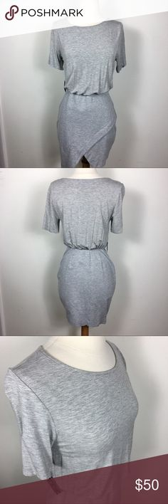 Nasty Gal Asymmetrical Body Con Baggy Top Dress Brand new with tag! Super cute gray jersey asymmetrical dress by Nasty Gal features Body Con Skirt with asymmetrical cute and baggy T-shirt top. Dress it up or down, very versatile. Nasty Gal Dresses Mini