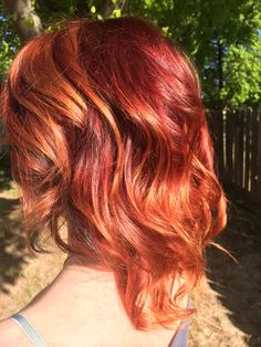 Fiery red to copper balayage ombré on short to medium length hair by Samantha Noel
