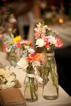 Mixed flowers with ribbon-wrapped clear jars Cecily & Matthews Rustic Cottage Point Wedding - Petal Photography