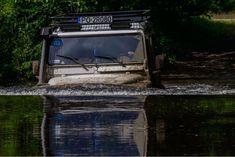 Defender... driving through water.