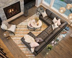 Favorite Living rooms.  Love the mix of elements in this space, the warm gray sectional, faux fur, and blush accents.