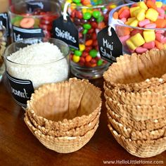 Candy-Covered DIY Ice Cream Sundae Bar ... an easy way to create summer time fun! Learn how to set up a sundae bar, including ideas for sundae toppings, decorations, and display. A fun + easy party idea for weddings, birthdays, baby showers, graduations, and other receptions! This make your own ice cream sundae bar is perfect for kids and adults alike! | Hello Little Home
