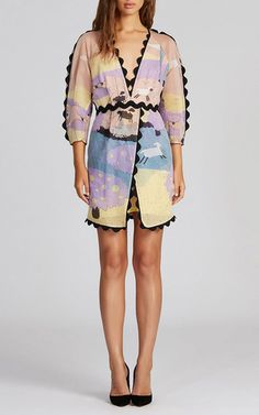 Rendered in a scenic print, this three quarter sleeve **Alice McCall** dress features a deep v-neck, a wraparound style skirt with a mini length, and contrasting scalloped trim throughout.