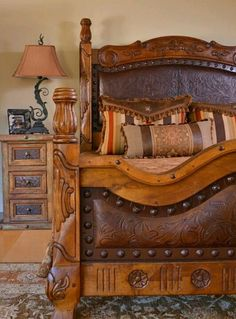 Western bed with tooled leather inserts and nail head trim