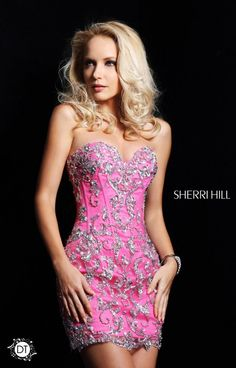 Sexy and chic and totally unique - the three words we think of when we see the stunning Sherri Hill 2974! What a gorgeous dress, and with TWO ways to wear it, this removable skirt style is flawless. This strapless look has a fitted corset style top with a sweetheart cut to it that is just beyond stunning. Seguins cross the body, balancing out with the bare legs or mermaid tulle skirt that you are working with underneath! *Removable Skirt