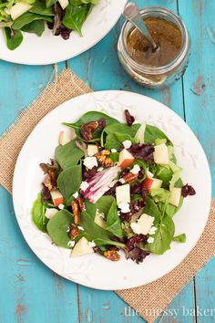 Winter Salad with Pomegranate Balsamic Vinaigrette: Candied pecans, apples, dried cranberries, and blue cheese get sprinkled over a bed of fresh greens.