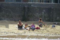 Sun bathing on the Thames forshore.