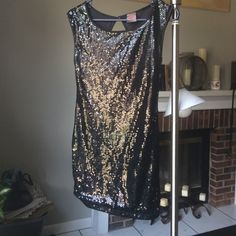 Black sequined small sleeveless mini dress I ner short and form fitting black sequined dress. Wore once for a perfect NYE outfit paired with colored tights and stilettos. I. Ner Dresses Mini