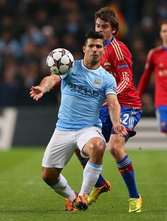 Sergio Agüero competes with Georgi Schennikov during the UEFA Champions League group D match between Manchester City and CSKA Moscow at Etihad Stadium on November 5, 2013 in Manchester, England.