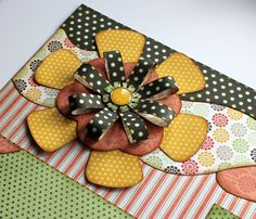 """Aren't They Cute? Today's post I'd like to focus on creating flowers with your strips. """"Aren't they cute?"""" I first saw this technique on one of Scrapbook Expo's Tip of the Day episodes on My Craft Channel. I immediately knew I could make them with our strips and could just see in my mind what …"""
