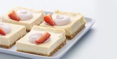 Chobani Yogurt -Strawberry Cheesecake Bars - 280 calories.  1 c Chobani Strawberry Greek Yogurt  1 c graham cracker crumbs   ½ c plus 2 T sugar, divided   4 T unsalted butter, melted   8 oz cream cheese   3 large eggs   3 T all-purpose flour   9 strawberries, thinly sliced