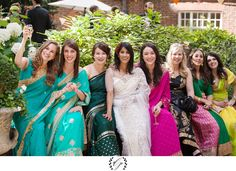bride and bridesmaids at cocktail hour in colorful Saris at the Stationers` Hall in London
