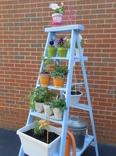 Repurpose and old step ladder to create a vertical garden
