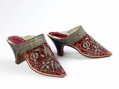 1651 - 1670  A pair of woman's mules ( supposed to have been worn by Queen Henrietta Maria. Continental. They are crimson velvet decorated with raised silver thread and sequin embroidery.