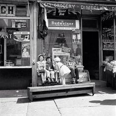 1954: New York City children in front of store inviting customers to vote for Miss Rheingold Beer. Photo by Vivian Maier - the photographer called 'A riddle, wrapped in a mystery, inside an enigma.'