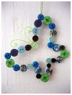 Have some leftover buttons and need some cool new craft ideas, too? You may want to go restock on buttons after you see these creative and easy DIY projects made with buttons. Cute Crafts, Crafts To Make, Arts And Crafts, Diy Crafts, Button Crafts For Kids, Diy Buttons, Butterfly Crafts, Butterfly Ornaments, Butterfly Wall