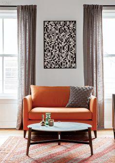 Black and white. Neutral. Orange sofa. Light.