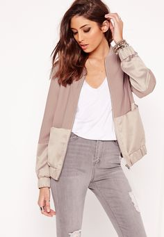 For a fierce layered look, you can't go wrong in one of our sassy bomber jackets. Featuring two tone fabric in contrasting textures, long sleeves and a luxe hue; this piece will get you noticed. Wear it festival style - throw on over a bral...