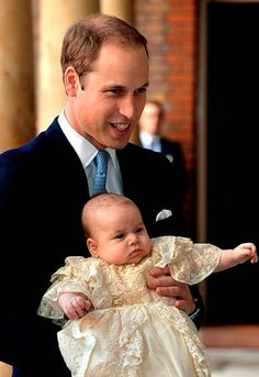 Prince William with his son Prince George on his christening day, October 2013