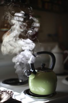 Tea pot steams in the morning sunlight before I pour my morning coffee. A daily ritual that brings me comfort.