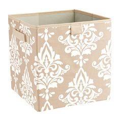 Perfect for corralling spare throws or office essentials, this versatile storage bin features 2 handles and a damask print.Product: