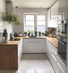 Happy kitchen has plants! 🌱 I& in love with these wooden benches and still on the side of the closet ❤️ gives a modern touch, right? And a fridge full of magnets because this is a real house! Kitchen Furniture, Kitchen Interior, Kitchen Decor, Home Room Design, Home Interior Design, House Design, Kitchen Sets, New Kitchen, Long Kitchen