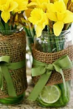 Mason jar with sliced oranges, white flowers, and mint ribbon!