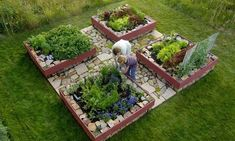 Supreme raised-bed garden quad. Each garden box measures 4' x 4'Whole garden measures 10' x 10', $3000