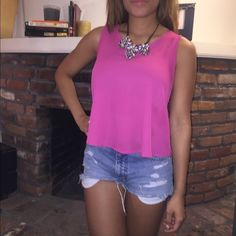 Bright pink tank with cut out back Great condition, bright pink tank! Cut out back :) size small Tops Tank Tops