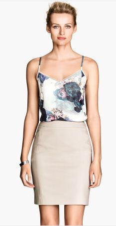 The cami is very feminine and high waisted skirt accents her body shape very well. I would totally wear this with a blazer or cardigan.