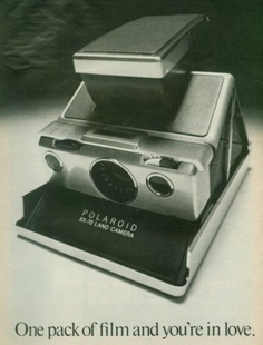 Polaroid ad. Would love to have one of these someday, just because.