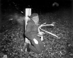 Photo taken at the instant bullets from a French firing squad hit a Frenchman who collaborated with the Germans. This execution took place in Rennes, France. November 21, 1944.