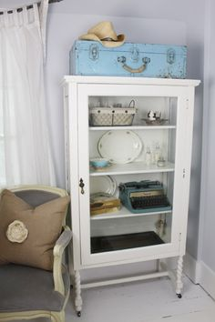love this! blue old tool box, cabinet, white wood floor
