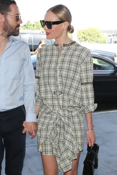 Plaid dress and a low bun.