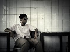 Seated, Shaded... Pheroze at the Indian Coffee House in Connaught Place, New Delhi.