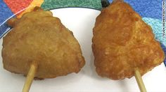 Deep fried hamantaschen on a stick for Purim  They are deep frying everything these days.   I remember making these every year in Hebrew School