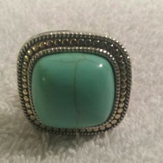 Womens silver and turquoise ring Beautiful large square turquoise and silver ring. Very pretty. Jewelry Rings