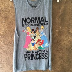 "Disney Princess Exercise muscle Tank Zumba XXL Great XXL tank. Heather gray with princess print. Says ""normal is too mainstream, that's why I'm a princess"". And they are all wearing glasses. This tank is best for exercise or with a sportsbra underneath. See last photo. I'm a LXL and it fits truer to an XXL. :) worn a few times. Washed. Screen print is still crisp.  Very cute! Disney Tops Muscle Tees"
