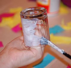 Home Made Modg Podge Recipe.  White school glue and water. mix enough water to make it a nice runny paint like consistency. It will go on looking 'filmy' but dries clear, make sure to cover your whole service with the glue and if it will be in a humid place or is an item that will get wet use a clear varnish spray to harden it and make it water resistant. wiki.answers.com/...